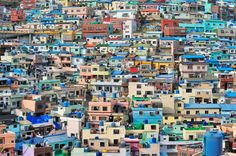 The Taegeukdo village in Busan, South Korea's second largest city, boasts plenty of color, including the bright-blue water tanks that are scattered across the rooftops. Busan Korea, Korea Trip, Rooftops, World Of Color, South Korea, City Photo, Places To Go, Photo Galleries, Scenery