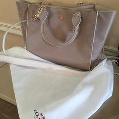 100% authentic over $400 value gray leather couch Like a brand new no tag ! Just sitting in my closet  coach caryall lovely soft gray Leather purse   comes with dust bag  top handle, shoulder or cross the body  Coach Bags Crossbody Bags