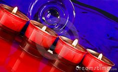 Row of red night light candles with flames.
