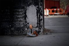 Artist Isaac Cordal makes little concrete people and places them in cities around Europe