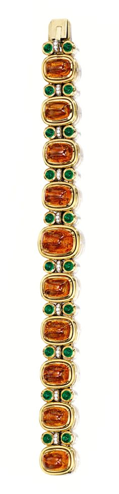 SPESSARTITE GARNET, EMERALD AND DIAMOND BRACELET, BULGARI.  The bracelet composed of ten graduated cabochon spessartite garnets together weighing approximately 52.00 carats, spaced by cabochon emeralds and circular-cut diamonds, length approximately 175mm, mounted in 18 karat yellow gold, signed.