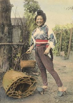 A Japanese farmer girl, in traditional clothing, carries a basket.