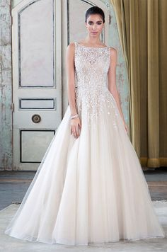 Beaded tulle ball gown embellished with a sabrina neckline. Justin Alexander Signature, Sprint 2016