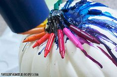 This is awesome. Crayons melted on white pumpkin. I think I would use just black crayons...would look so cool!