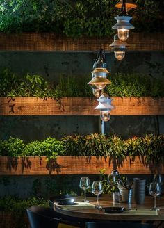 Marset - Santorini pendant lamps by Sputnik Estudio at Segev Kitchen Garden in Israel. Interior design by Studio Yaron Tal. Outdoor lighting for restaurants
