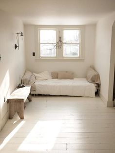 What a simple and stunning room. The interior colors are: Walls - BM White Dove and trim/doors: BM - November Rain.