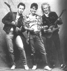John McEnroe and Vitas Gerulaitis playing guitar, with Eddie Van Halen on tennis racket