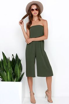 When you want to boogie down, the Full Tilt Olive Green Strapless Midi Jumpsuit is the perfect dance partner! Textured woven poly forms an elasticized strapless bodice that meets with an elastic waist, then transitions to chic, midi-length culottes with diagonal front pockets, and breezy wide-cut legs. Unlined. 97% Polyester, 3% Spandex. Hand Wash Cold. Made With Love in the U.S.A.