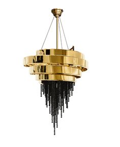 """Hailed as the most important structure of its time designed, Guggenheim Museum is called the """"temple of the spirit"""" to smooth the way of looking at the modern pieces. It was this connection that inspire us to create the Guggenheim Chandelier, a perfect lighting solution for your luxury home. Its main materials are brass and Swarovski crystals and it's finished with gold plated."""