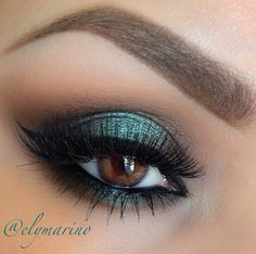 Turquoise metallic smokey eye.