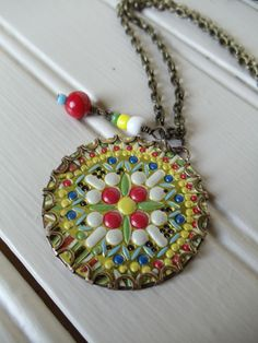 Re-purposed Tin pendant Necklace by Nostalgic Summer Vintage Inspired Jewelry @ http://www.facebook.com/nostalgicsummer