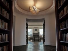 This Navicula greets all who enter this Chelsea penthouse in Manhattan. The fixture is framed by a wonderful coved ceiling & is central to the design of the space.  The uplit fixture gazes out upon Gotham City with a view of the Freedom Tower in the South and the Empire State Building to the North.  wakanine.com/navicula