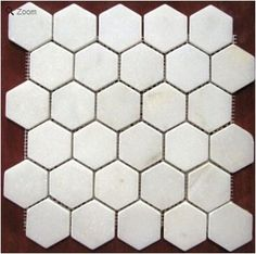To see our collection of Hexagonal floor Tile visit us http://mosaictiledirect.net/left-category/stone-collections/white-carrara-marble-collection/2-in-x-2-in-white-tumbled-hexagon-pattern-mesh-mounted-marble-mosaic-tiles-4-in-x-4-in-sample-5-00-free-shipping.html