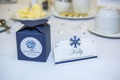 A lovely winter traditional favour box with a heart shaped top. Inside - a scented candle to warm your winter days.