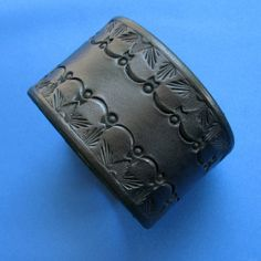 WANT IT!  On etsy...Wide Tooled Leather Cuff  Variation on Reticulation by aosLeather, $32.00