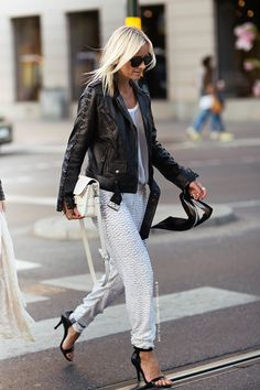 mesh top from Dovre, scarf from Holzweiler, sunglasses from Celine, vintage sequins pants, pumps from Alexander Wang, bag from Proenza Schouler and a leather jacket from Caroline Blomst.