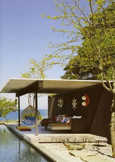 Jonathan Adler outdoors I like this because its a floating dock, of course we'd change the décor!