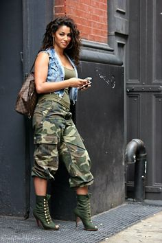 This combo of a blue denim vest and olive camo cargo pants gives off a very casual and approachable vibe. Take a classic approach with the footwear and go for a pair of olive cutout satin booties.   Shop this look on Lookastic: https://lookastic.com/women/looks/vest-tank-cargo-pants/12702   — Blue Denim Vest  — Olive Tank  — Dark Brown Check Leather Tote Bag  — Olive Camouflage Cargo Pants  — Olive Cutout Satin Ankle Boots