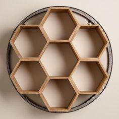 One of my favorite discoveries at WorldMarket.com: Round Metal and Wood Honeycomb Wall Storage