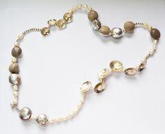 El patchwork no es sólo para las telas. Semillas de mate, laminilla de plata, plata 925 y perlas.