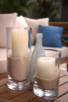 For a simple, and safe display, bury candles halfway in sand in vases