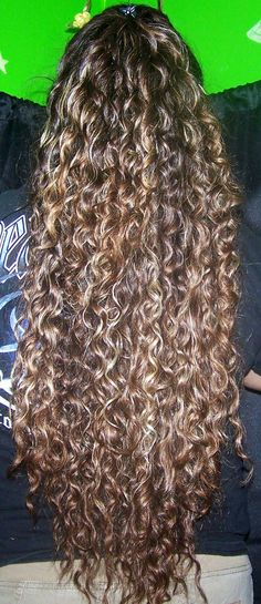 Beautiful Long Curly Hair; my reaction when i saw this.. *gasp* WHAT? wouldn't want my hair THIS long, but longer than what it already is on me