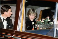 Prince Charles, Prince of Wales and Diana, Princess of Wales leaving the Royal Albert Hall after a concert, February 1982.