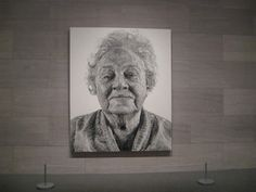 "In 1985, artist Chuck Close applied oil paint directly on his fingertips to create a masterful portrait of his grandmother. ""By adjusting the amount of pigment and the pressure of his finger on the canvas, Close could achieve a wide range of tonal effects. Typically, he worked from a black and white photograph which he would divide into many smaller units by means of a grid. He then transposed the grid onto a much larger canvas and meticulously reproduced each section of it."""