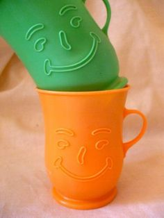 Kool-Aid cups. Ours were white and we had the Kool-Aid Man pitcher to go with them. Lol