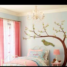This is what Sophia got for Christmas a new big girl room this is not her room but this is exactly what hers looks like. I got the idea from here and loved it and so does she.