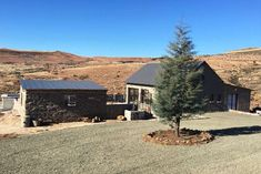 Ridge Rd Cottage - Clarens Accommodation. Horse Paddock, Horse Stables, Pond Covers, Aluminium Sliding Doors, Bedroom With Bath, Queen Room, Pet Friendly Accommodation, Free State, Wrought Iron Gates