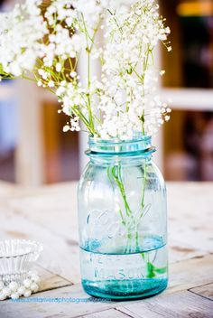 Our wedding mason jars with Baby's Breath. Inexpensive, understated, and gorgeous.