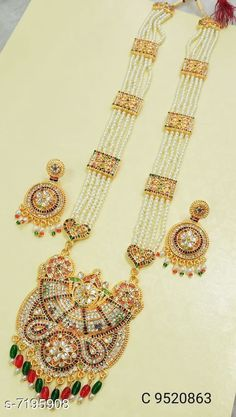 Jewellery Set Jewellery Set Base Metal: Brass Plating: Gold Plated Stone Type: Artificial Stones Sizing: Adjustable Multipack: 1 Country of Origin: India Sizes Available: Free Size   Catalog Rating: ★4 (415)  Catalog Name: Twinkling Unique Jewellery Sets CatalogID_1148596 C77-SC1093 Code: 693-7195908-5001