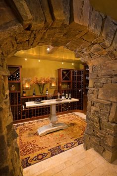 forget the wine room, I want a stone archway like that:)