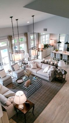 large living room design idea. I don't love all the white but the layout is very nice.