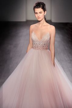 Sherbet tulle bridal ball gown, ruched sweetheart bodice with beaded shoulder strap, keyhole back, ombre jeweled band at natural waist, tulle skirt trimmed with horsehair, chapel train. Also available in Ivory.