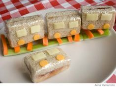 Make the cars of the train by cutting a sandwich into quarters with cheese circles and rectangles for wheels and windows.
