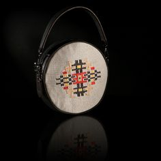 """The handmade woven round bag """"Iris"""" adorns a pattern inspired of a traditional female outfit of Thrace. The color of the leather is black and the background is in grey silk weaving. Art Bag, Round Bag, Iris, Design Art, Hand Weaving, Traditional, Silk, Inspired, Female"""