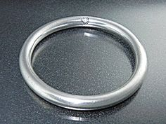 Taxco Mexico Sterling Silver Bangle Bracelet 1/4 inch Wide inner diameter 2 1/2 inches 38 Grams rounded Edges with a mark inside the round 925 Mexico TO-34 which looks like HI