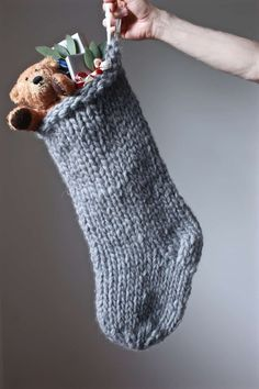 how to knit a christmas stocking – love this chunky stripy nordic style stocking in grey. Click through for expert tips and links to the perfect knitting pattern - How to knit a Christmas stocking - From Britain with Love Knitted Christmas Stocking Patterns, Cute Christmas Stockings, Chunky Knitting Patterns, Knit Patterns, Knitting Stitches, Super Chunky Wool, Chunky Yarn, Chunky Knits, Crochet Hook Sizes