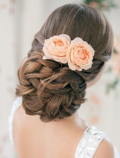 low bun wedding updo hairstyles with flowers