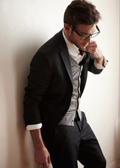 Black blazer, paired with gray cardigan. Crisped white button up and skinny black tie. Classic tones.