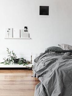 greys, white and wood for a bedroom