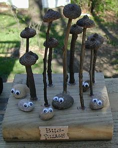 This is a fun nature craft made from rocks or stones, acorns and sticks or twigs.  if you don't have a scrap piece of wood, you can use the top of a shoe box or a flap from any cardboard shipping box.