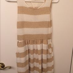 Gold and white dress with pockets. Cute gold and white dress with pockets. Perfect for any occasion. Monteau Dresses Midi