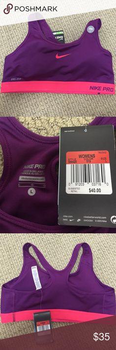 Nike sports bra Nike purple and pink sports bra.  New with tags, never worn. Nike Intimates & Sleepwear Bras
