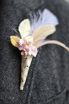 Not so sure about the feathers but great idea!   {DIY} Vintage Music Boutonniere Posy | Austin Weddings | Austin Wedding Blog