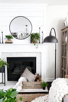 Plum Pretty Decor & Design Co.Spring Living Room Update with HomeGoods — Black Swing arm lamp and a modern farmhouse fireplace. Spring Living Room Update with HomeGoods- Modern Farmhouse Living Room by Plum Pretty Decor & Design Co. Farmhouse Fireplace, Home Fireplace, Fireplace Design, Fireplace Ideas, Modern Fireplace Decor, Modern Mantle, Small Fireplace, Mirror For Fireplace, White Mantle Fireplace