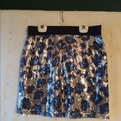 Forever 21 Sequin Mini Skirt All that glitters, beautiful black, blue and silver sequined mini skirt, L, excellent condition... Forever 21 Skirts Mini