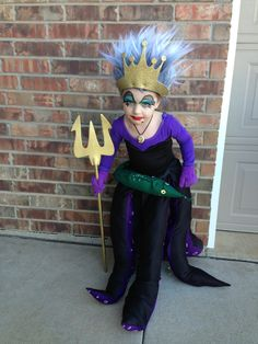 Ursula Halloween costume DIY! Sewed fabric onto a,leotard, made the tentacles to wrap around her waist. Also added puffy paint for the suctions. Spray painted a seashell charm for the necklace, spray painted a red septor, gold crown from hobby lobby, and it is an Albert Einstein wig!
